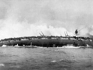 The sinking SMS Blücher rolls over onto her side.