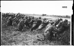 French soldiers waiting assault behind a ditch