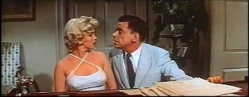 Ewell leans in for kiss in The Seven Year Itch trailer 1.jpg